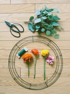 DIY - FRESH FLOWER CHANDELIERS Janie Medley Flora Design and captured by Rachel May Photography Visit The Bride's Cafe for the how to's!