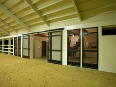 Speetzen Ranch | GH2 Gralla Equine Architects. Crosshatch mesh horse stall door by Lucas Equine