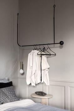 Hanging Coat Rack, Coat Hanger, Hotel Strasbourg, Grey Feature Wall, Dark Ceiling, Green Cabinets, Fluffy Rug, Coat Stands, Striped Wallpaper