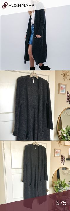 🐨Free People Santa Cruz Cardigan Beautiful dark grey long cardigan in great condition. Super soft and warm, has a really nice hang and great seam detailing on the back shoulders. Pockets on front. Marked size Small, fits like an FP small, which is more like a S/M. Depending on desired fit this could go for an XS-L. Free People Sweaters Cardigans