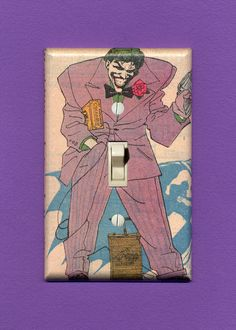 The Joker. Not sure I'd trust touching that switch... Quality-made vintage comic book lightswitch plate.