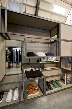Metal Shelving cubes.  Warming up the bottom and backs would be key to keeping it from feeling to dirty and dull