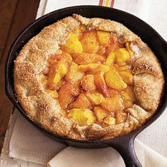 Rustic Spiced Peach Tart with Almond Pastry | MyRecipes.com.  This looks so delish and I love cooking in my cast iron skillets!
