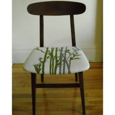 Teak chair with graphic cushion