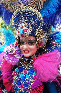 The Jember Fashion Carnival 2013 belongs to Indonesia. Dazzling: A JFC participant dresses up in a bejeweled purple costume. The JFC has gained national and international recognition for its main costume parade. (Photo by Icha Rahmanti)