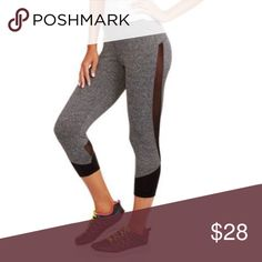 Capri leggings with mesh paneling Sporty look, yet comfortable. Grey pants made from cotton, polyester, spandex, and mesh paneling. Moisture wicking technology helps evaporate moisture. Fitted through out, medium rise, partial fold over elastic band. Grey and black. True to your size. boutique item Pants Capris