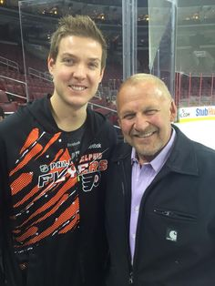 The Man behind the mask;  Bernie Parent with Flyers goaltender Steve Mason.