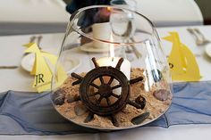 DIY Nautical CENTERPIECE it's easy and cute! Love the helm- and the candles can be navy or red too