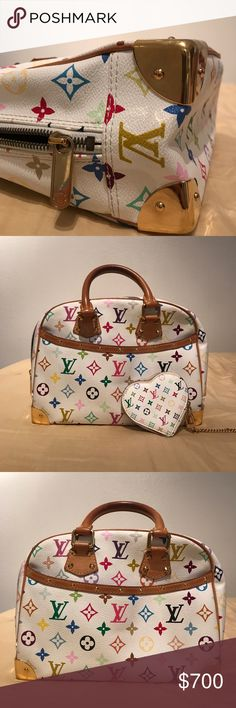 Louis Vuitton Trouville Multicolor Monogram White This is an authentic LOUIS VUITTON Multicolor Trouville in White. This chic tote is finely crafted of Multicolore Louis Vuitton monogram in 33 vibrant colors on white toile canvas. The bag features vachetta cowhide rolled leather handles and trim with polished brass hardware including decorative studs and corner plates. The top wrap-around zipper opens to a raspberry red alcantara microfiber interior with patch pockets.   Gently Used Louis…