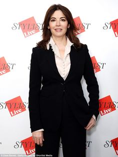 Quirk-wear: Nigella Lawson favoured a business dress code as she slipped into a two-piece suit and a wide-collared pink blouse to attend a fashion and culture festival in London on Satuday