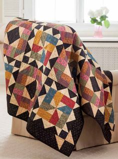 Enjoy the Starlit Path digital pattern from Fons & Porter's Scrap Quilts 2013 issue. Skillfully orchestrated color combinations in this quilt create a secondary pattern punctuated by stars in each cross section. Choose to make it with a planned fab