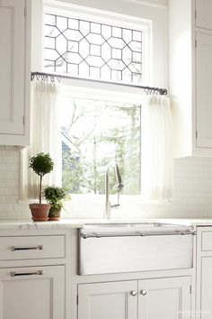 marble counters | metal farmhouse sink bright white kitchen