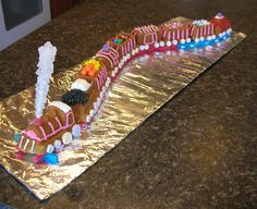 """For Valentine's Day this year my friend and I made a cake shaped like a train! This would also work beautifully for a Christmas train, or any other occasion where a sugar covered, edible miniature train was the appropriate thing to make. We used the Williams-Sonoma """"Railway Cake Pan"""" to build the cake itself, and a variety of candy to do the decorating."""