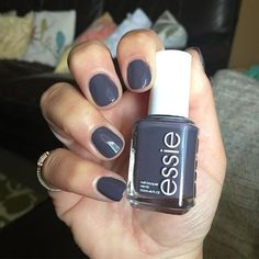 ESSIE Winning Streak• as a dark purple with a grayish tone.