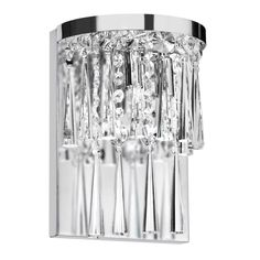 Crystal prisms and beads dangle from this luxurious light fixture to imbue your decor with contemporary elegance. Finished in polished silver, this lustrous wall sconce features two lights to help uplift and brighten your space.