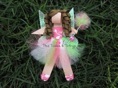 Custom Fairy hair clip comes with fluffy tutu and matching wire, bead poofy wand, shimmery/glitter wings. you pick skin, top, tutu, shoes, hair color and hair style. Printed Ribbon for top,shoes varies with what I have in stock but for sure all solid colors are available.