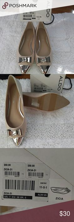 Silver Bow Tie/Spike Flats Adorable & Edgy! Shiny, Spikes, and Bow ties! Never worn! Brand New...been sitting in closet. 👍 Soft pinkish/beige coloring. Soft like suede material. Great details. Aldo Shoes Flats & Loafers