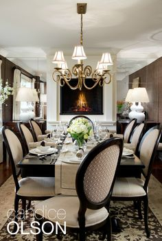 DINING ROOM FIREPLACE 2/2: Mirrored niches on either side of the fireplace double the apparent size of the room and help balance the rich, dark walls with reflected light.  #candiceolson