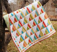 Try your hand at creating a fun triangle quilt with this lap quilt tutorial! This throw quilt pattern uses honey buns to create its sleek modern design. Jelly Roll Quilt Patterns, Beginner Quilt Patterns, Quilt Patterns Free, Quilting Tutorials, Quilting Projects, Quilting Ideas, Sewing Projects, Jellyroll Quilts, Lap Quilts
