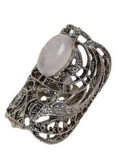 Though it's a classic accessory, this ring will make an eye-catching statement on your hand. The ornate, silvery design features two mirror image peacocks showcasing an ice pink gem.  women's fashion and style.
