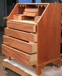 Hand cut dovetailed drawers in a Massachusetts Slant Front Desk