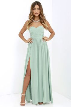 You'll be admired as soon as you set foot in the party wearing the Moonlight Serenade Sage Green Strapless Maxi Dress! Draping woven poly fabric adorns a strapless sweetheart neckline with lightly padded cups and no-slip strip. A gathered waist introduces a full, maxi skirt with sexy side slit. Hidden back zipper and clasp.