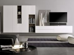 Search all products, brands and retailers of Storage walls: discover prices, catalogues and new features Front Room Design, Tv Wall Design, Family Room Design, Interior Design Living Room, Wall Storage Systems, Tv In Bedroom, Cabinet Decor, Living Room Tv, Furniture Design