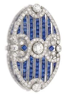 Sapphire and diamond brooch, circa 1910. Designed as an open work plaque millegrain set with calibré-cut sapphires, circular-cut and rose diamonds, indistinct marks, fitted case signed London & Ryder, 17, New Bond St., London, W. #Edwardian #brooch