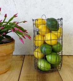 Store a weekly supply of onions, several limes and lemons for summertime porch beverages or a bouquet of wildflowers in this wall hanging wire basket. Designed to mount on flat vertical surfaces, you can hang the steel basket anywhere you've got a little nook. Just install a hook or nail in your kitchen or entryway to hang it from the attached loop.
