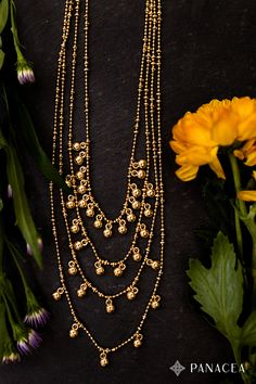Layer fun on top of your look with this multi-strand necklace sprinkled with gold beads. Goes great with spring layers and scarves.