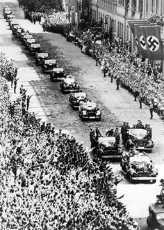 """ANSCHLUSS WITH AUSTRIA MARCH A triumphant Hitler drives through Vienna with tens of thousands of Viennese giving him a delirious welcome. With Austria under the swastika, Hitler's """"Greater Germany"""" was finally a reality -- to last until World History, World War Ii, Hassan 2, Photos Rares, Invasion Of Poland, The Third Reich, Austria, Old Photos, Wwii"""