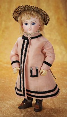 rare early bebe,wearing original rose silk/linen dress with black velvet trim and pearl buttons,undergarments,bi-color woven bonnet,Jumeau earrings,black knit socks,and black leather shoes (one signed E.J.). http://Theriaults.com