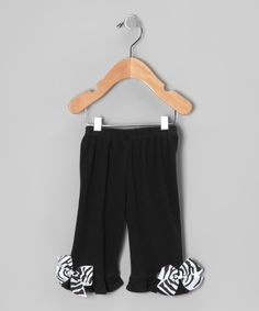 Love this Petunia Petals Black Zebra Bow Ruffle Pants - Infant & Toddler by Petunia Petals on #zulily! #zulilyfinds