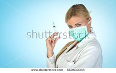 Young female blonde doctor with blue eyes, posing with vaccine syringe