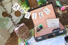 "This was the table at the entrance of Kate's shower-we had printed out Mad Libs entitled ""Kate and Jordan's Wedding Vows"" and sheets that guests could write advice for Kate and Jordan along with their address for thank you cards.  It was so pretty!"