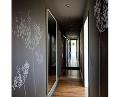Vinyl on walls and full mirrored end makes it look longer.