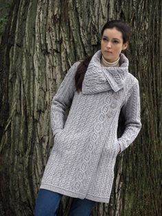 Every woman's winter wardrobe should include a high quality sweater.  I was recently introduced to The Sweater Shop, a 100% Irish owned and managed company that offers free shipping to the US.  Right away I fell in love with the beautiful knit designs.  I had a hard time choosing which one to get but settled on this Chunky Aran Button Coat.  Grey is my favorite color but I need to branch out a bit and thought Navy was a good choice.  I love the asymmetrical collar on this sweater.  It clo...