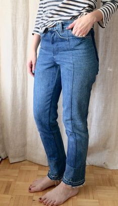 I took two pairs of old Levi's (thrift store find), cut them in half lengthwise and sewed them back together. I also restitched the pockets and recycled the waistband. The hem is some sort of unpicked and restitched thingamajigg I came up with along the way.