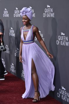 """Lupita Nyong'o in Elie Saab at the premiere of Disney's """"Queen Of Katwe. Mode Turban, Purple Gowns, Turban Style, Costume, Red Carpet Looks, Scarf Hairstyles, Red Carpet Fashion, Beautiful Black Women, Elie Saab"""