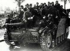 A Sturmgeschütz III tank destroyer in the role of transporting retreating Germans during the days after Normandy, June 1944.