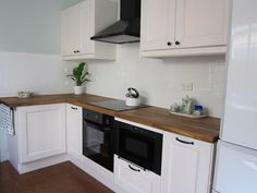 Ramsjo white IKEA cabinets, love the butcher block and subway tile