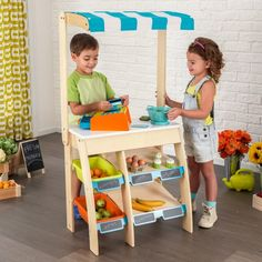 Kids can explore their entrepreneurial side with our KidKraft Play Grocery Store Marketplace. The set includes shelving with removable plastic bins to stock items, chalkboard signs to label them, a fabric awning, an interactive cash register and a play cr Play Grocery Store, Fabric Awning, Multiplication For Kids, Plastic Bins, Cash Register, Extra Storage, Kind Mode, Teaching Kids, Storage Spaces