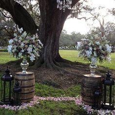 whiskey barrels at weddings   Mrs. Vintage   Whiskey barrel altar w/ lanterns and gorgeous florals ...