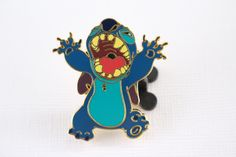 This Disney pin for sale features alien experiment 626 Stitch with his mouth open and hands up. He is rare from Paris 2009 with a gold finished back. Guaranteed Authentic and Scrapper-Free. Earn rewar
