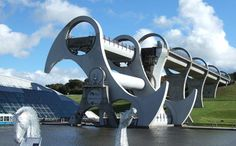 The Falkirk Wheel, Scotland. A bit more functional than spies or legends, Scotland has also constructed a unique massive spinning wheel that grabs boats from one river and plops them down safely into another, 25 meters below. This is not fantasy. This is Scotland.
