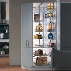 """Kessebohmer pantry door frame pull-out with tray and wire basket storage shelvesHooks on one side, left or right mounting to top and bottom cabinet panelsMinimum inside cabinet width = (basket width) + (1-7/8"""")Minimum inside cabinet depth: 20-1/4""""Height adjustable from 45-3/4"""" to 58-7/8""""Weight capacity: 88lbsTrays are steel frame with melamine shelfWire baskets are steel with polished chrome finish"""