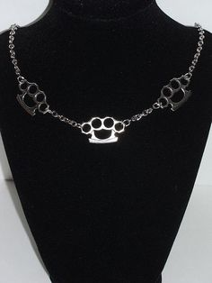 Brass knuckles necklace by VampyVulcan on Etsy - ONLY $6.99!!!