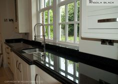Black and White kitchen with granite worktop by Polish granite Ltd