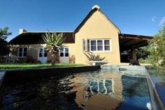Located in Ladismith, in a valley among wine lands, Mymering Guest House has luxurious rooms with a hot tub and some with a fireplace. South Africa, Mansions, Luxury, House Styles, Outdoor Decor, Travel, Home Decor, Viajes, Decoration Home