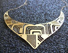 Designer necklace with geometric elements. 24k gold plated necklace with goldfield chain. $89.00, via Etsy.